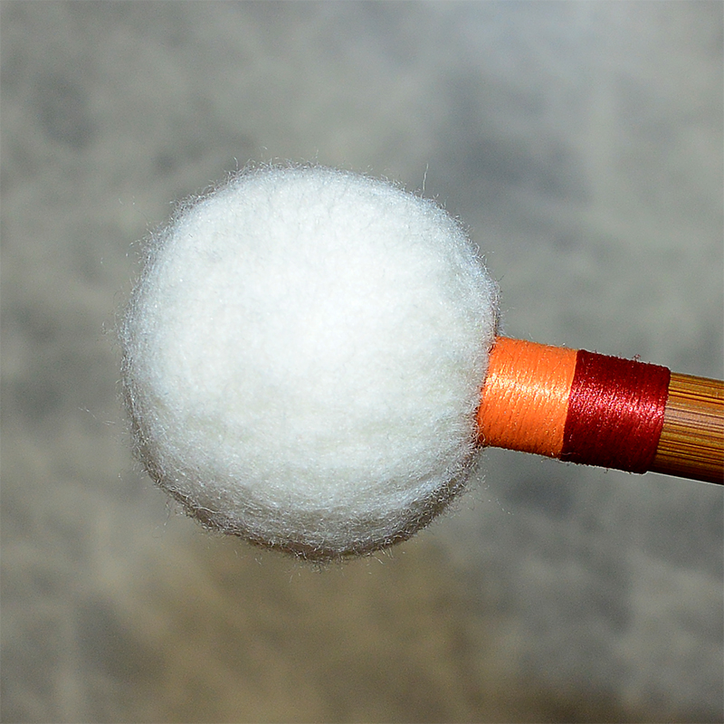 Traditional multilayer textile core mallets for full resonance.